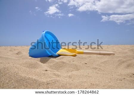 Sand toys at a beach - stock photo