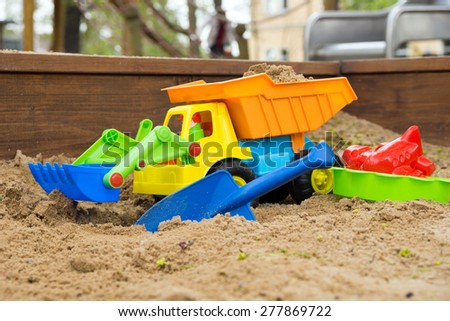 Sand toys in a sandbox / Sand toys - stock photo