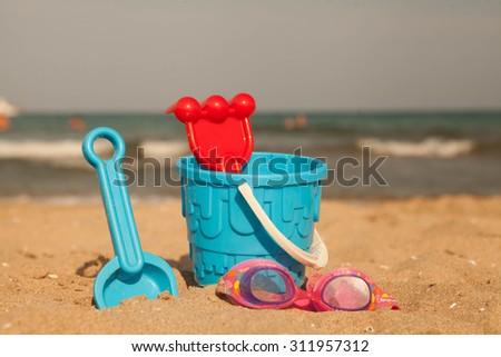 Sand toys on the beach of Lake Balaton. - stock photo