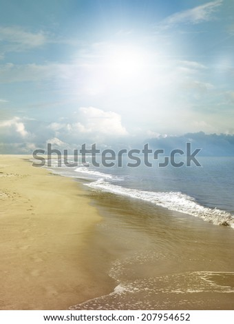 Sand, water and sky beach scenery