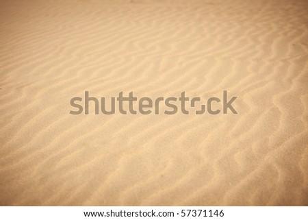 Sand waves on the beach - stock photo