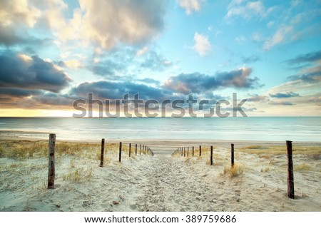 sand way to the North sea beach and beautiful sky, Holland - stock photo