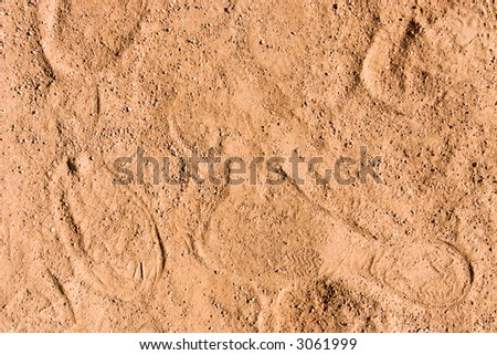 Sand with footsteps. Texture or background. - stock photo
