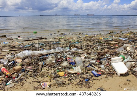 SANDAKAN, MALAYSIA - 16 JUNE 2016: Plastic garbage pollution on beach. Bottles and bags pollute the environment. - stock photo