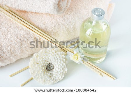 Sandal oil and sticks for spa procedures - stock photo