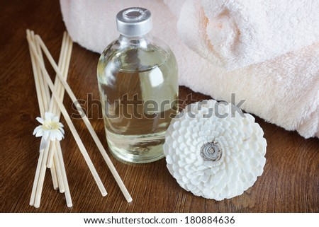 Sandal oil in a bottle and sticks for aromatherapy - stock photo