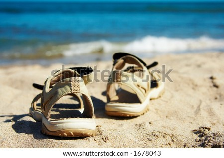 Sandals going to swim - stock photo