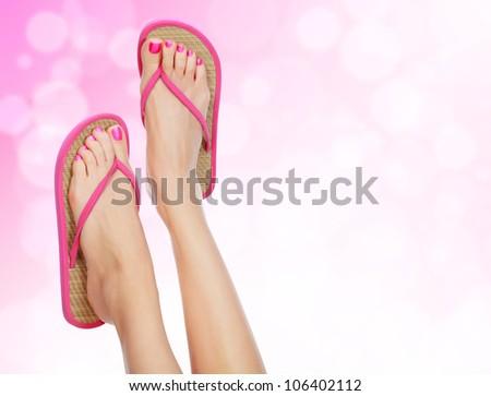 Sandals on female feet - stock photo