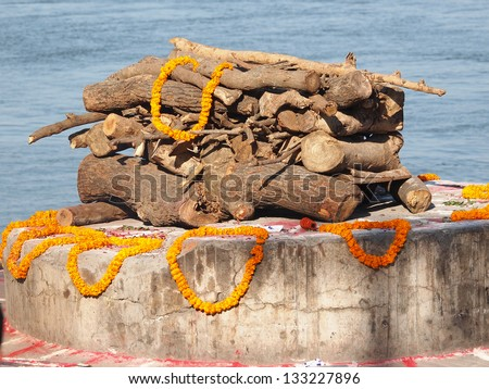 sandalwood and flowers for cremate ceremony on ganges in Varanasi - stock photo