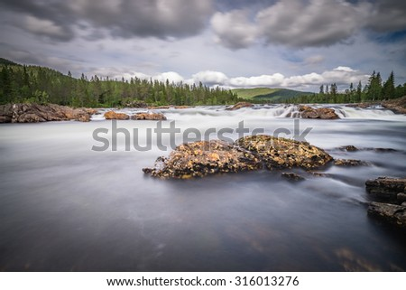 Sandamofossan waterfall in the north or Norway - stock photo