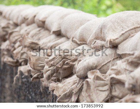 Sandbags on floodwater to stop the water who comes in. picture with short focus. - stock photo
