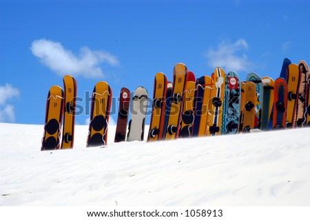 Sandboards in the Dunes - stock photo