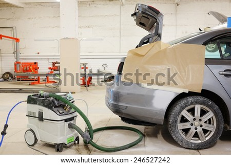 sanding machine in the body shop - stock photo