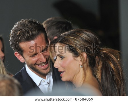"Sandra Bullock & Bradley Cooper at the world premiere of their new movie ""All About Steve"" at Grauman's Chinese Theatre, Hollywood. August 26, 2009  Los Angeles, CA Picture: Paul Smith / Featureflash - stock photo"