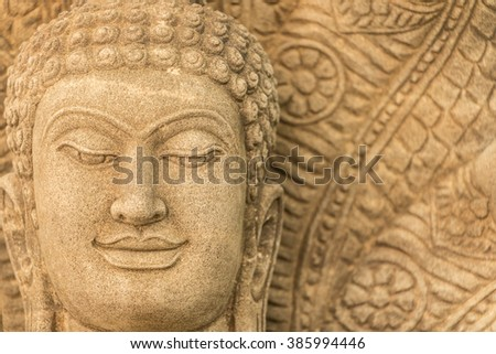 Sandstone Buddha image in Thailand country hundreds of years age.