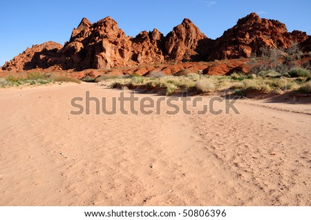 Sandstone Hills above a wash in Valley of Fire State Park - stock photo
