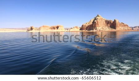 Sandstone island in scenic Lake Powell National Park in Glen Canyon Recreation Area in Utah and Arizona - stock photo