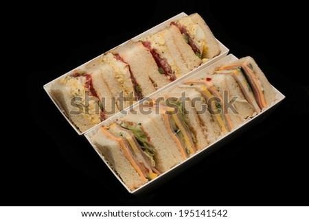 Sandwhiches isolated on black - stock photo