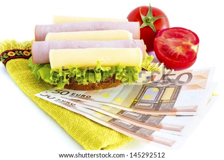 Sandwich and money which represents the hunger for money - stock photo