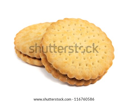 sandwich biscuits with chocolate filling on a white background - stock photo