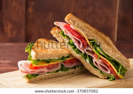 Sandwich bread tomato, lettuce and yellow cheese - stock photo