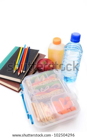 Sandwich, carckers, apple, orange juice, water bottle, books and color pencils - stock photo