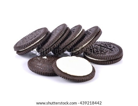 sandwich cookies with cream on white background