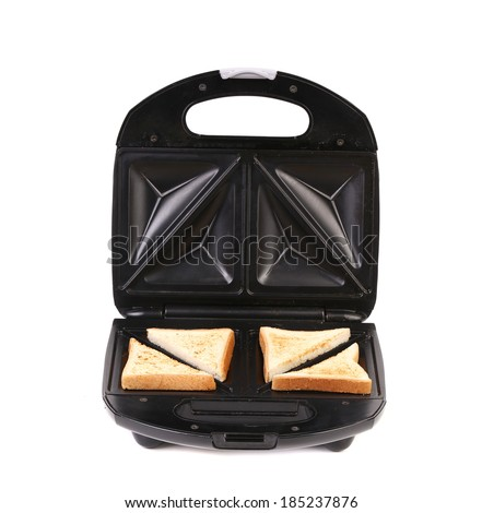 Sandwich maker with bread. Isolated on a white background. - stock photo