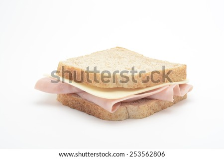 Sandwich of cooked ham and cheese - stock photo