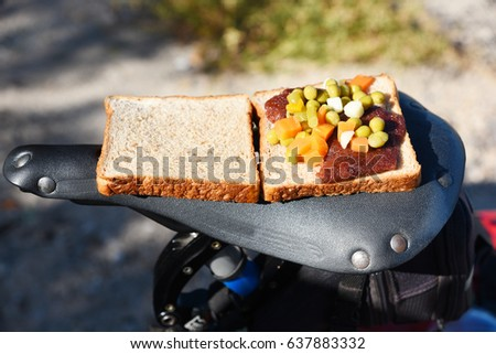 Sandwich on a top of a bicycle saddle