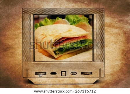 Sandwich on TV - stock photo