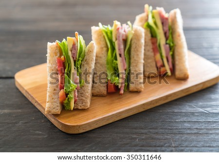 sandwich  on wood background - stock photo