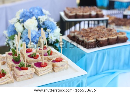 sandwich sticks and brownie cakes in cocktail wedding party - stock photo