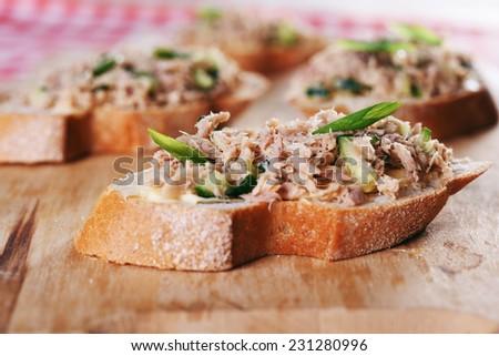 sandwich tuna fish salad on wooden background - stock photo