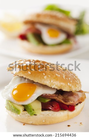 sandwich with avocado, egg, pepper and bacon - stock photo