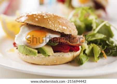 sandwich with avocado, egg, roasted peppers and bacon - stock photo