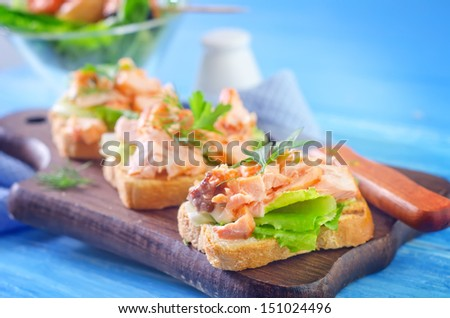sandwich with baked salmon - stock photo