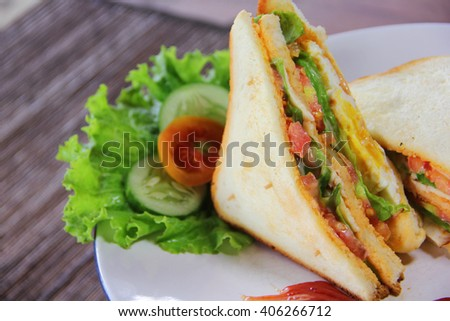 sandwich with beef,tomato and lettuce on platter