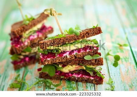 sandwich with beet,cheese,avocado and arugula - stock photo