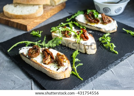 Sandwich with cheese and half dried tomatoes. selective focus - stock photo