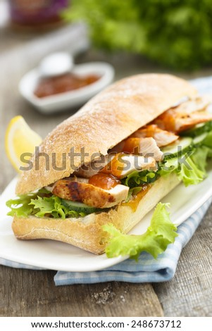 Sandwich with chicken and mango chutney - stock photo