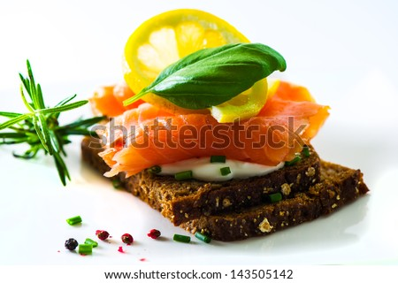 Sandwich with cream cheese and smoked salmon - stock photo