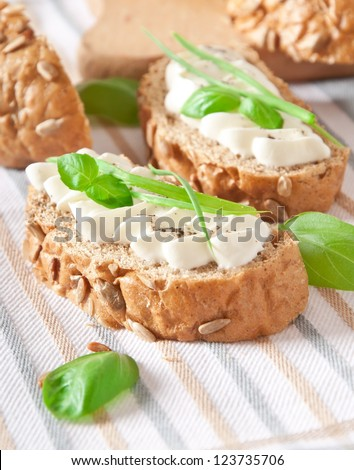 sandwich with cream cheese, basil and green garlic - stock photo