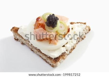 Sandwich with cream cheese, ham and caviar, close-up - stock photo