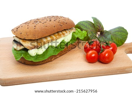 Sandwich with fish on a chopping board with a row lying tomatoes on a white background, nobody. Sandwich with a stuffing from meat cutlet, vegetables and mayonnaise with ketchup. - stock photo