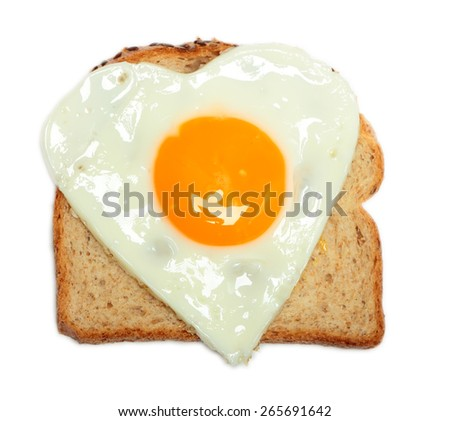 Sandwich with fried egg in shape of heart isolated on white background - stock photo