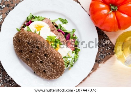 Sandwich with grilled beef steak, eggs, arugula, rye bread, tatsy lunch - stock photo