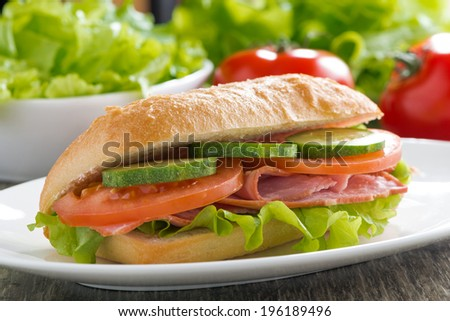 sandwich with ham and fresh vegetables, close-up, horizontal - stock photo