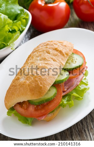 sandwich with ham and fresh vegetables, top view, vertical - stock photo