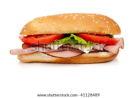 Sandwich with ham, turkey, roast beef, lettuce, tomato and cheese on a white hoagie bun on a white background - stock photo
